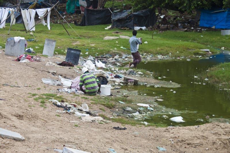 居住在贫民窟的可怜的人员 免版税库存照片