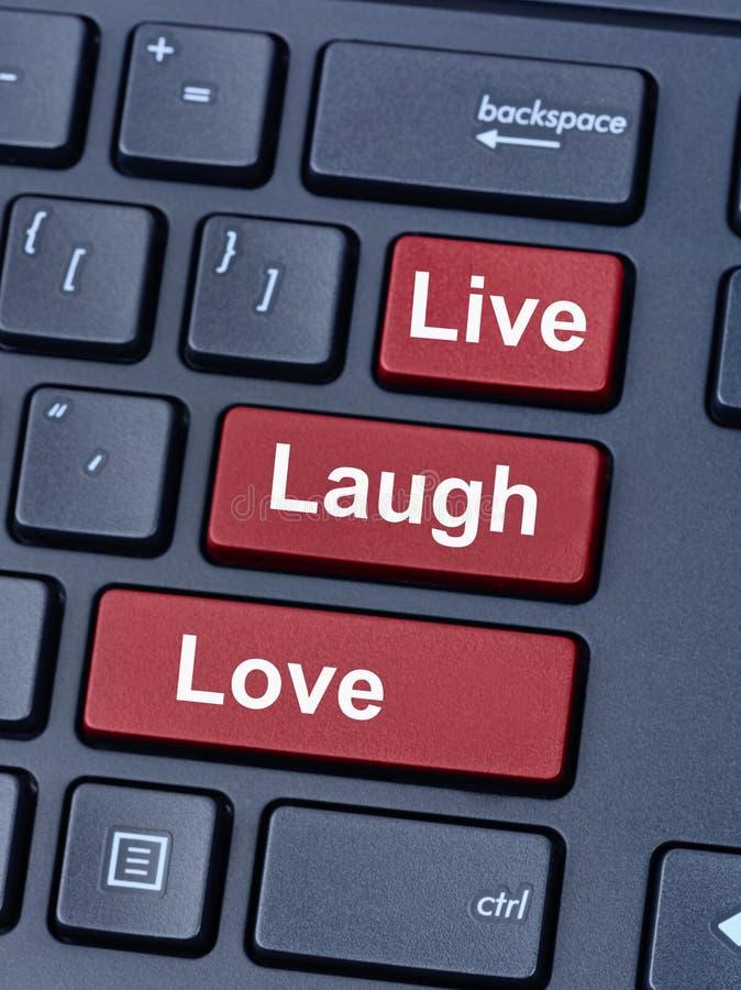 居住笑在键盘的爱词 库存照片