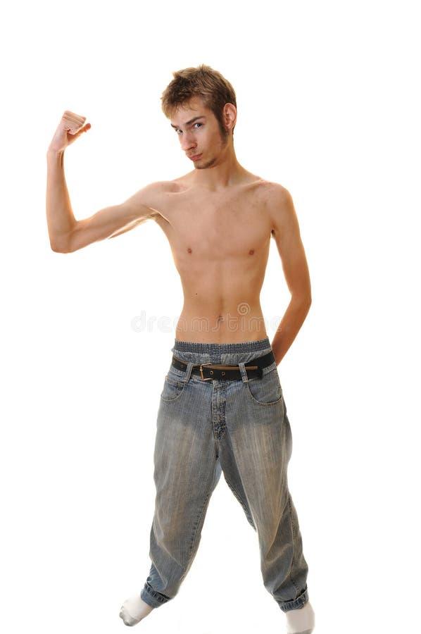 屈曲男性皮包骨头的年轻人 免版税图库摄影