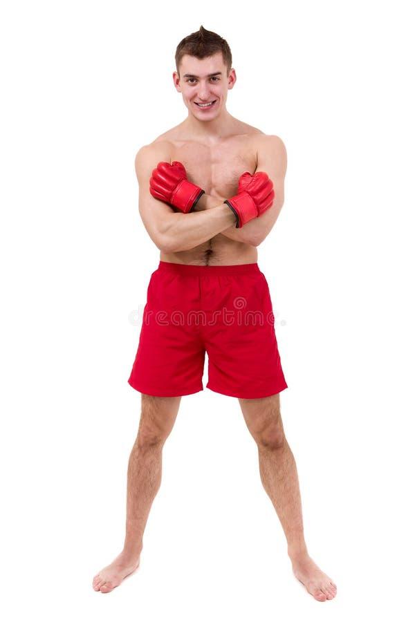 屈曲肌肉的年轻男性拳击手全长画象被隔绝在白色 库存图片