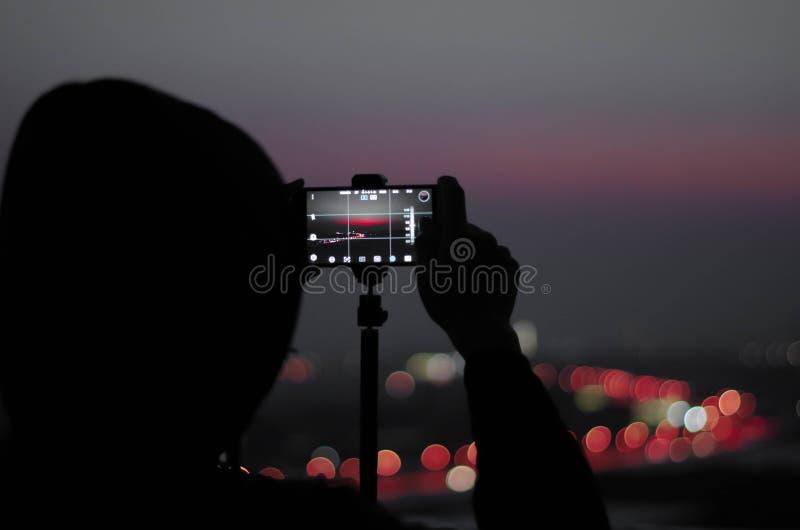 屋顶的一位摄影师 免版税图库摄影