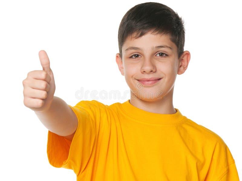 展示微笑的少年赞许 图库摄影