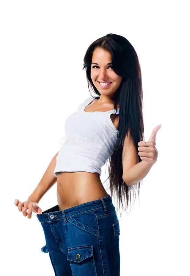 展示愉快的损失重量妇女 免版税图库摄影