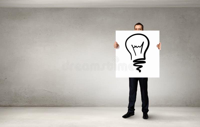 展示横幅有想法的商人 免版税图库摄影