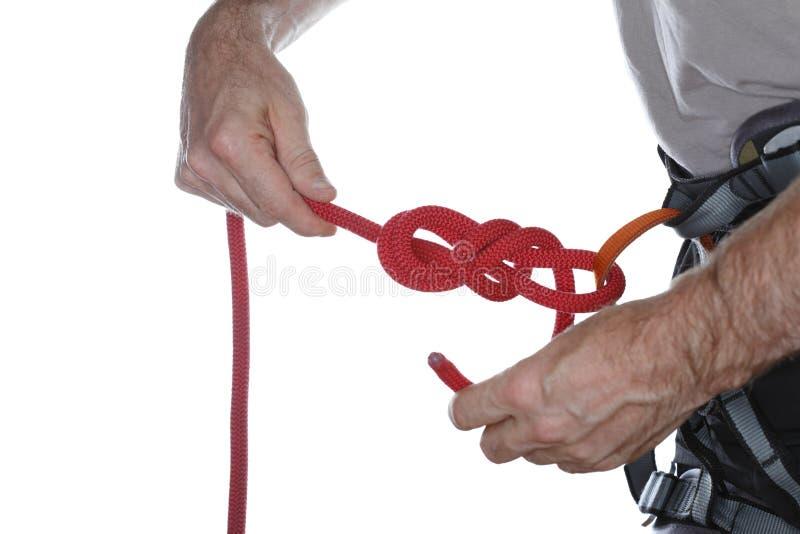 登山人打结绳索 免版税库存图片