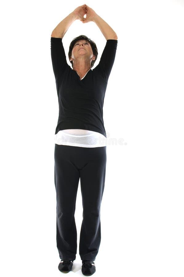 山位置s tadasana女子瑜伽 免版税图库摄影