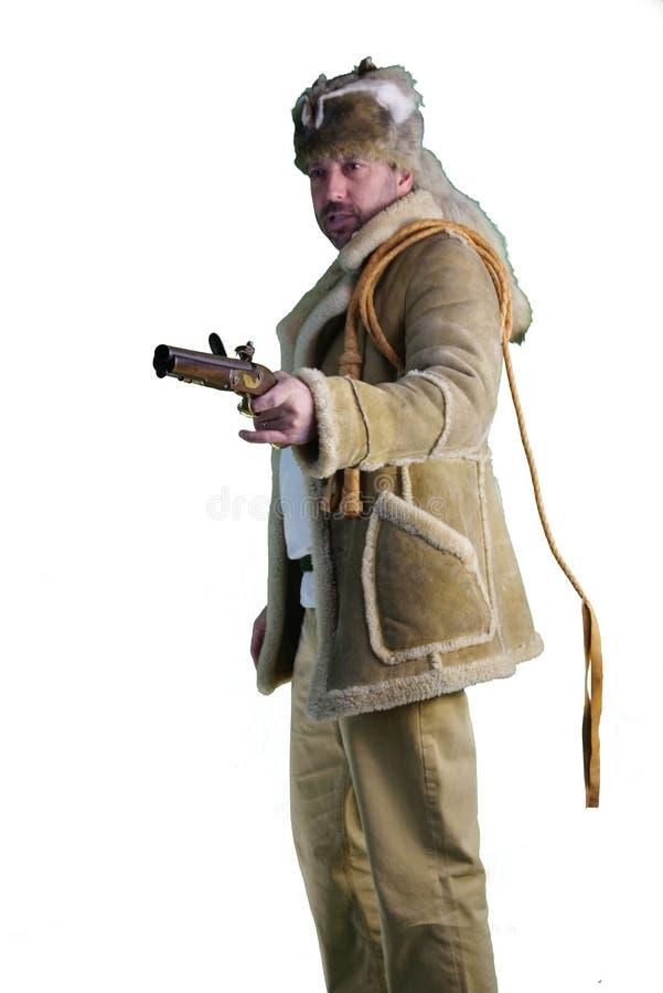 山里人, coonskin帽子,燧发枪手枪,紧身连衫外套 免版税库存照片