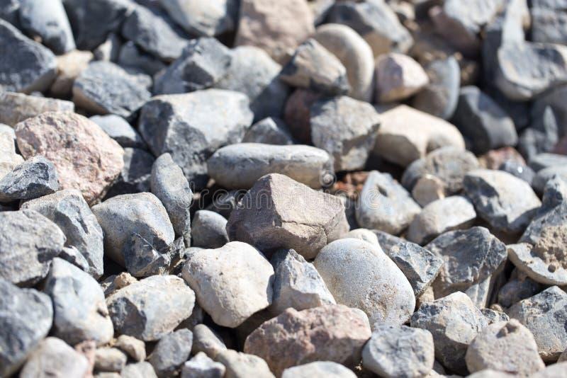 岩石本质上作为背景 纹理 免版税库存照片