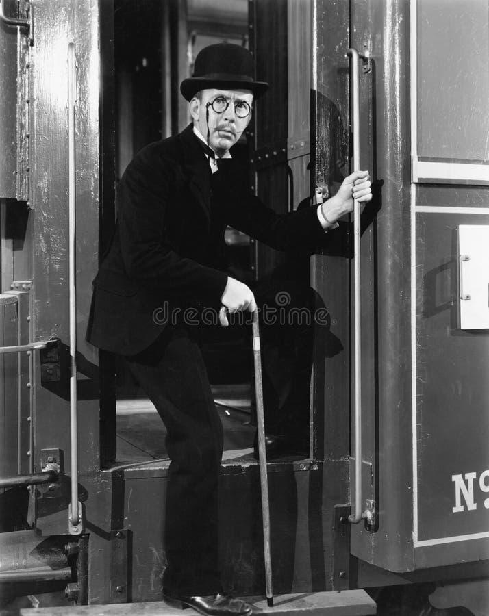 登岸火车的一个人的画象(所有人被描述不更长生存,并且庄园不存在 供应商保单Th 免版税库存照片