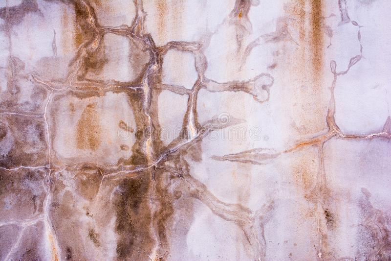 崩裂的混凝土墙固定与硅树脂表面 库存图片
