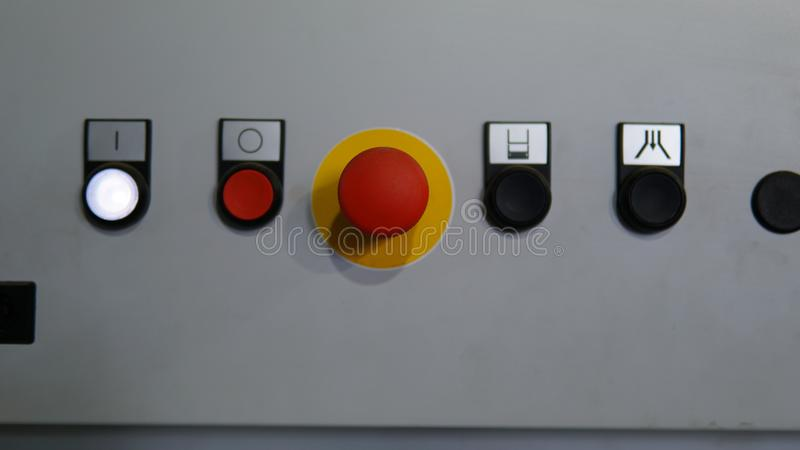 工业生产方法的塑料红色停止键与其他按钮 免版税图库摄影