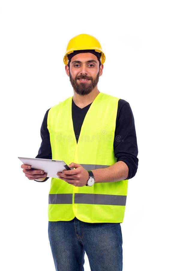 年轻工人微笑 免版税库存图片