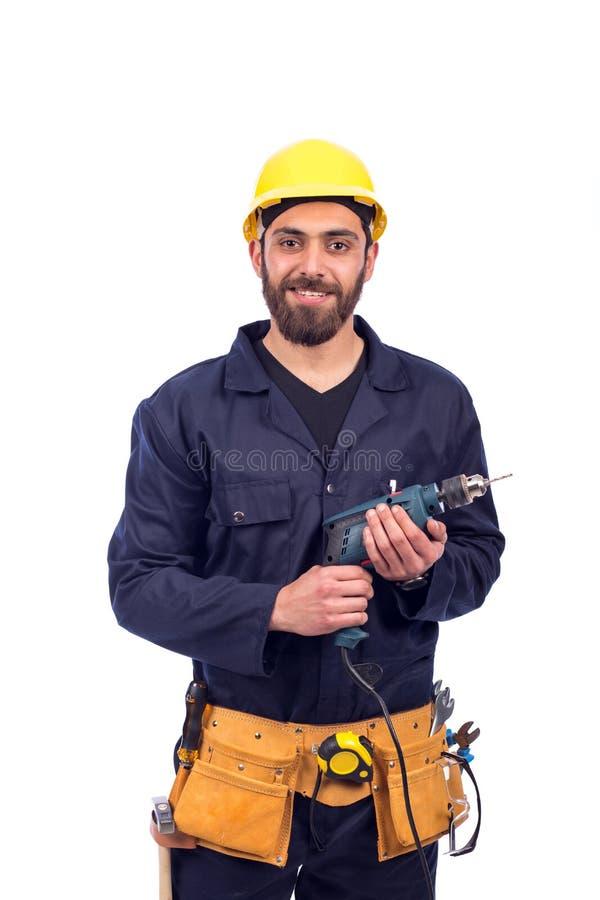 年轻工人微笑 库存照片