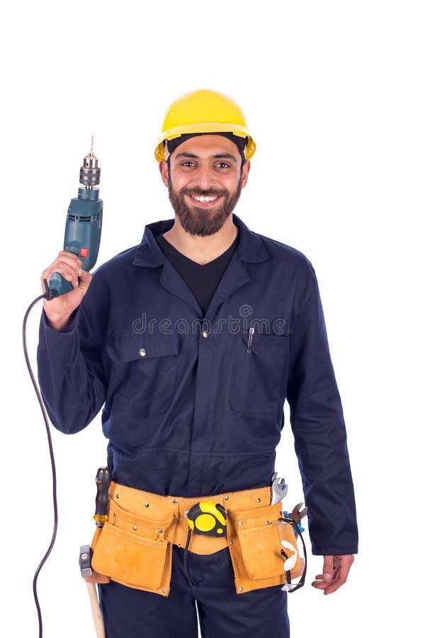 年轻工人微笑 免版税库存照片