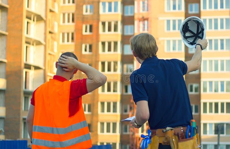 工伤事故建筑师工作在contruction站点的 免版税库存图片
