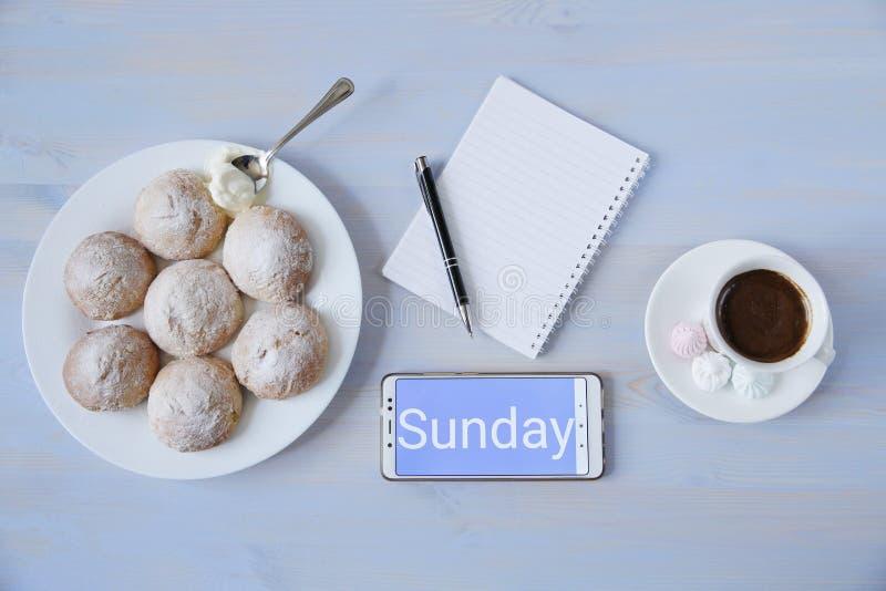 工作区顶视图与电话和题字的与咖啡、曲奇饼和笔记本有拷贝空间的 免版税库存图片