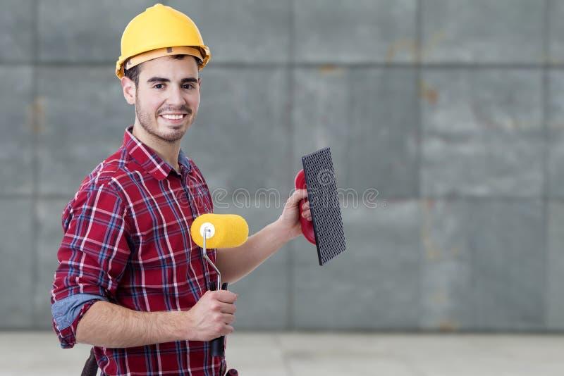工作和绘的瓦工工具 免版税库存照片