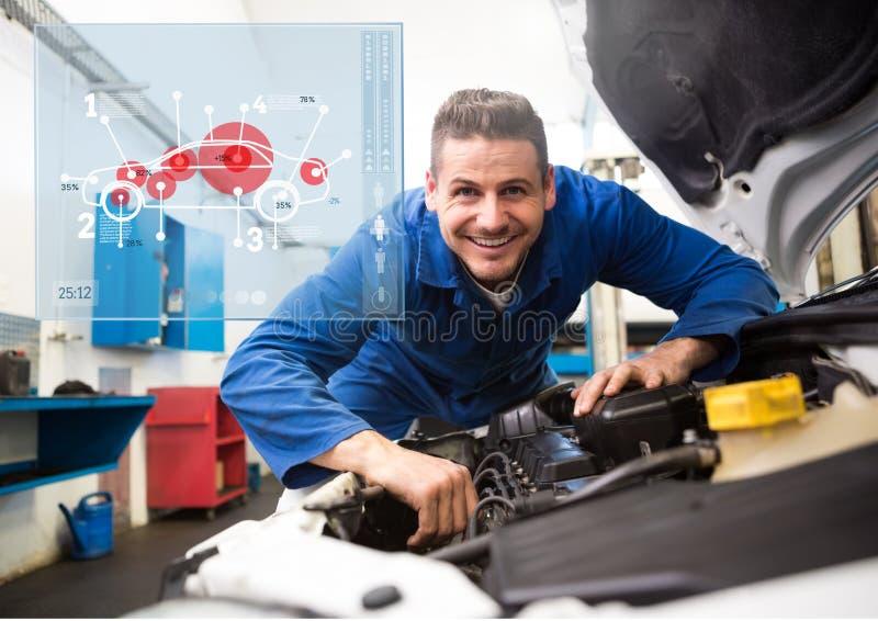工作在车库的技工反对汽车修理师在背景中连接 免版税图库摄影