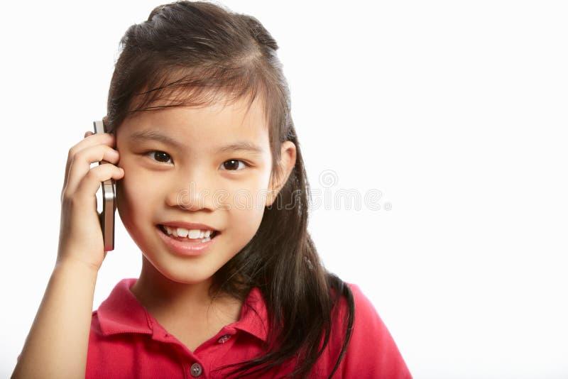 工作室射击了有移动电话的中国女孩 图库摄影
