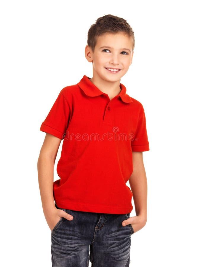 工作室的俏丽的男孩作为时装模特儿。 库存图片