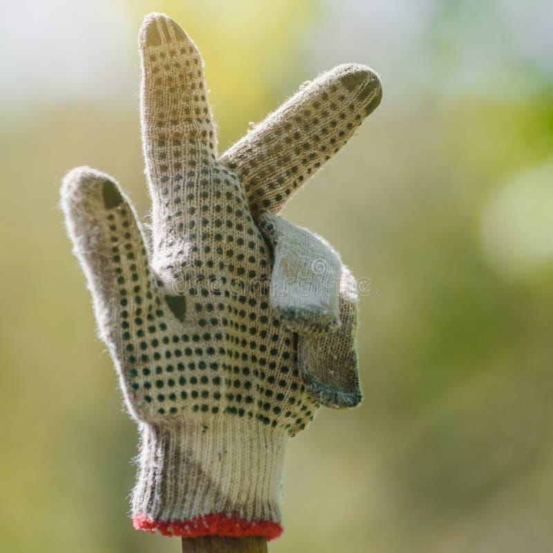 工作手套打手势 免版税库存照片