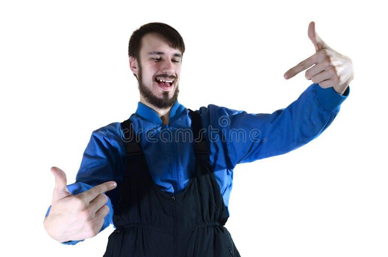 工作的一致的点一个年轻有胡子的人对他自己用他的两只手 免版税库存照片