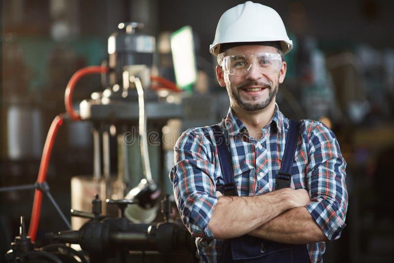 工作者佩带的安全帽 免版税库存照片