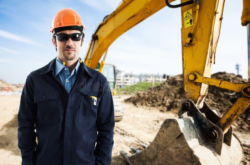 工作者在建造场所 免版税库存照片