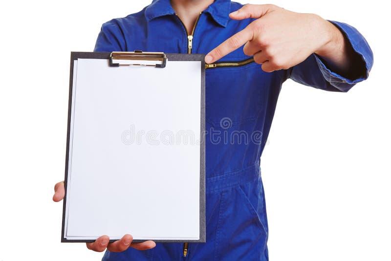 工作者指向的手 免版税图库摄影