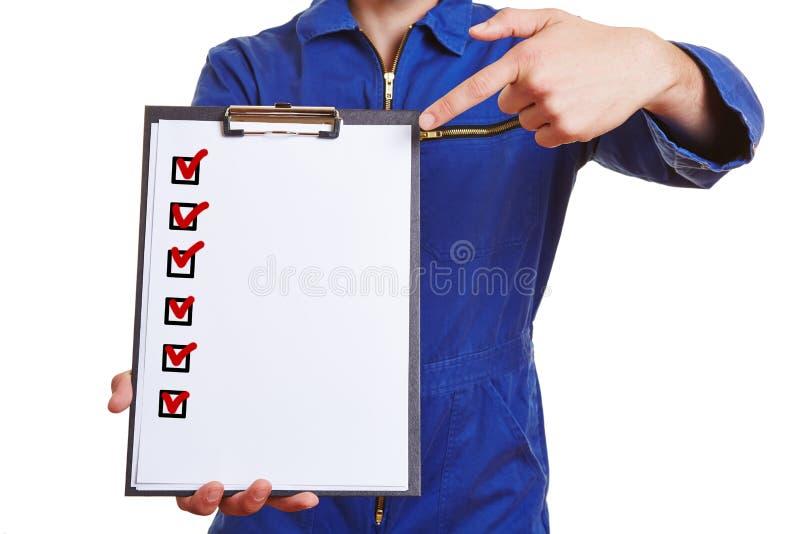 工作者指向的手 免版税库存图片