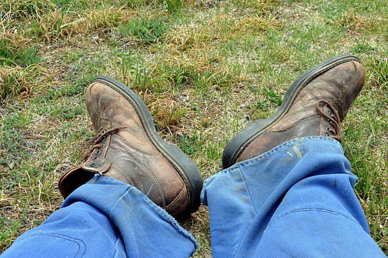 工作裤和靴子 库存照片