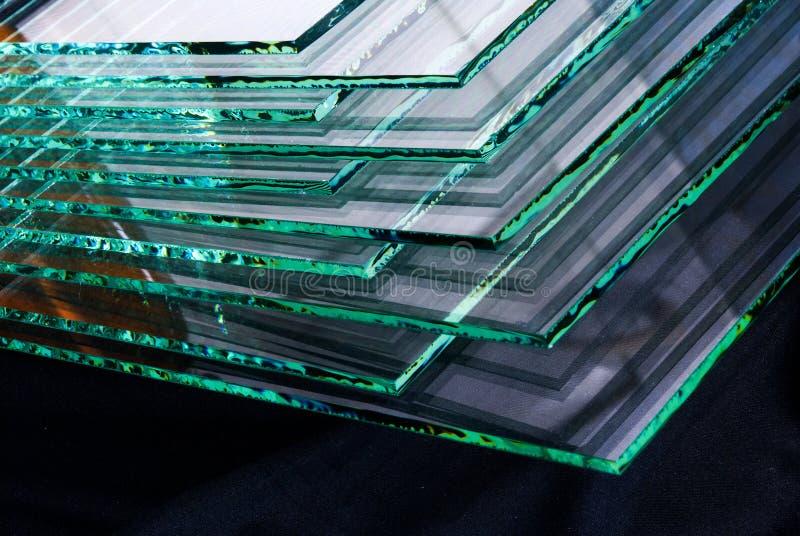 工厂制造的缓和清楚的浮法玻璃盘区板料按尺寸裁剪的 免版税库存照片