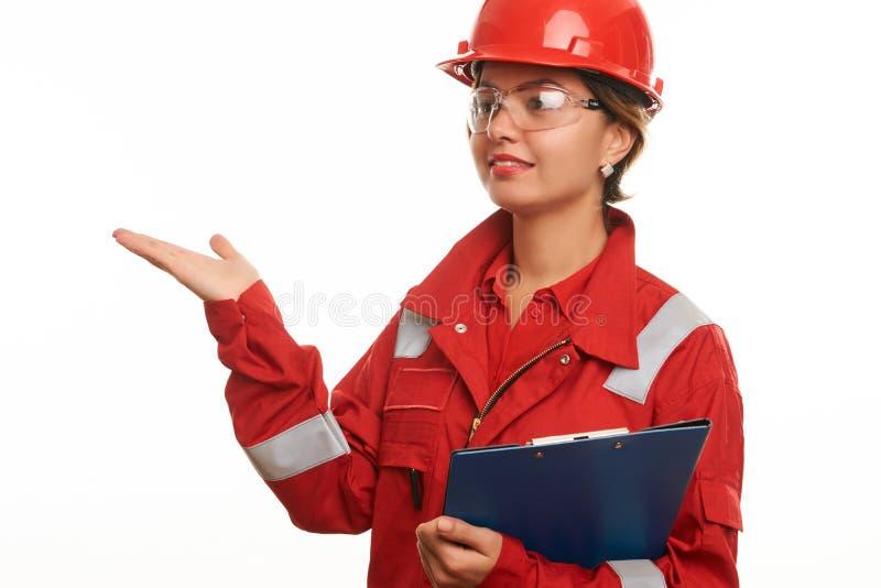 工程师安全制服的建筑工人妇女 免版税图库摄影