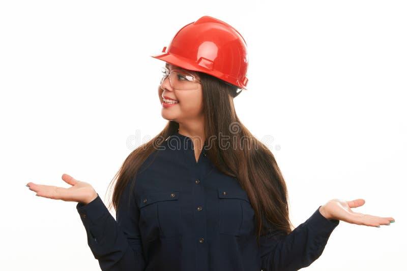 工程师或建筑师防护安全帽的建筑工人妇女 免版税图库摄影