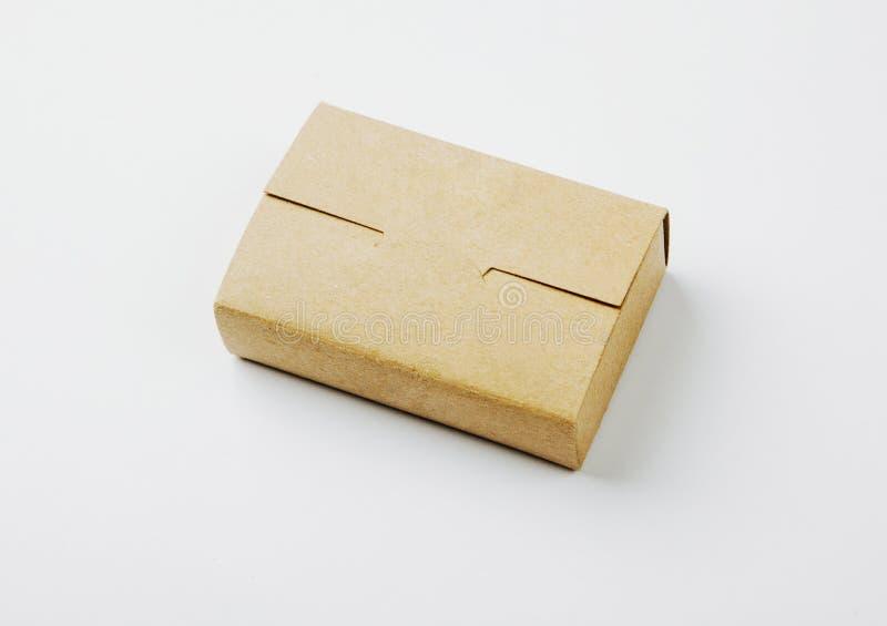 工艺在白色背景的名片箱子照片  水平 免版税图库摄影