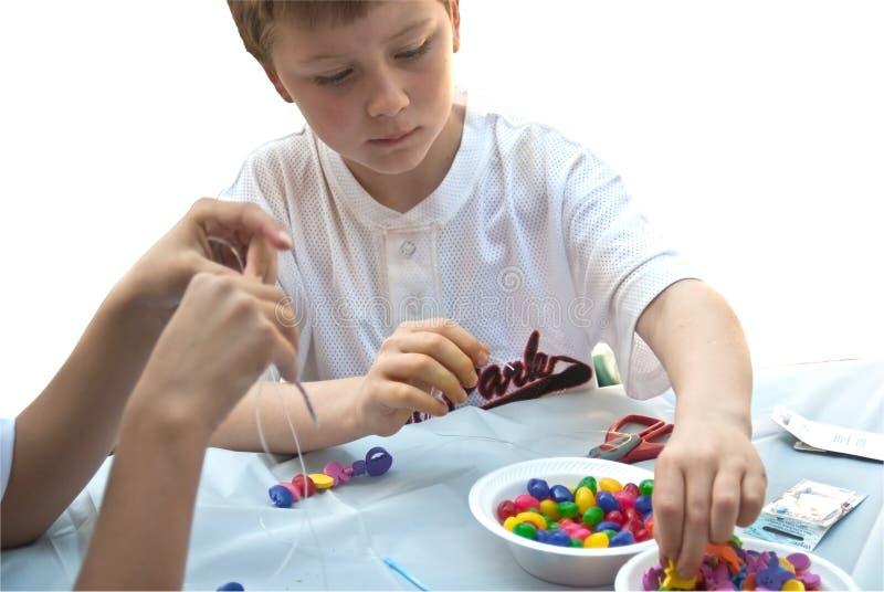 工艺孩子做 免版税图库摄影