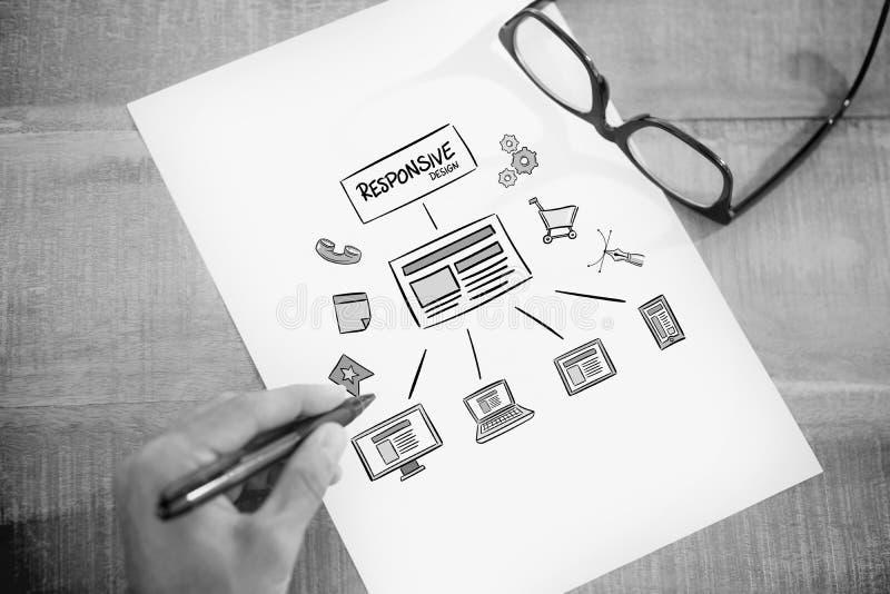 左手文字的综合图象在白页的在运转的书桌上 库存图片