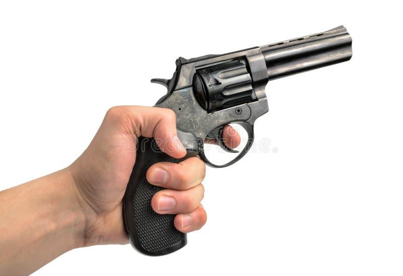 左轮手枪枪在手中在白色背景 免版税图库摄影