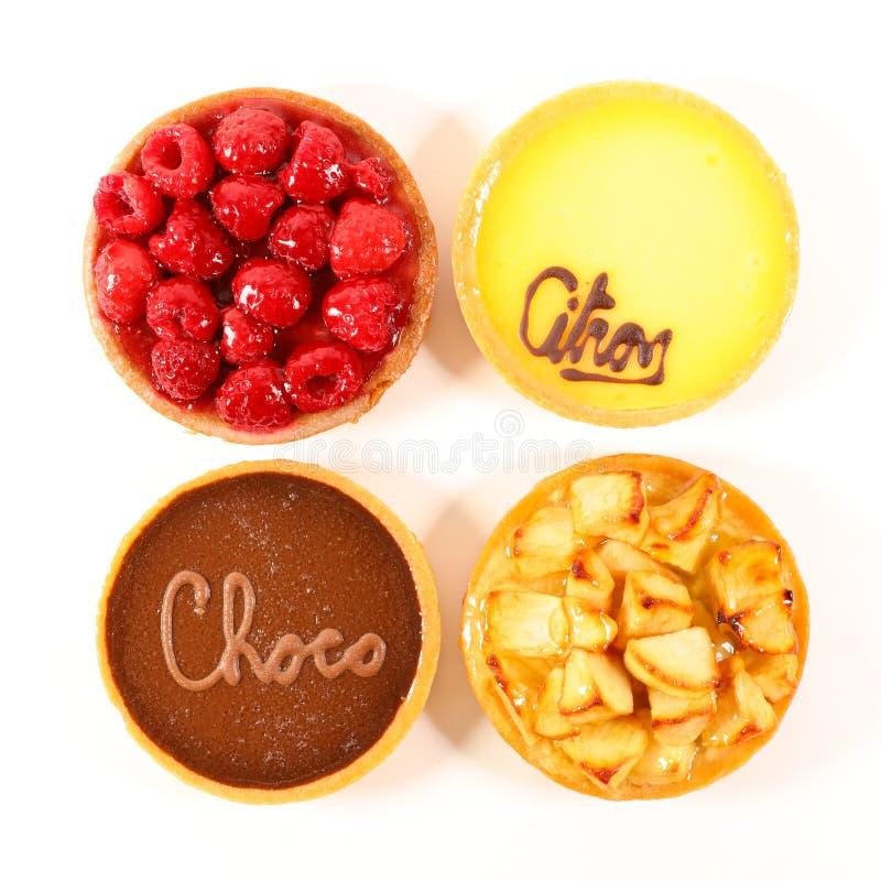 巧克力、莓、柠檬和苹果饼 免版税库存照片