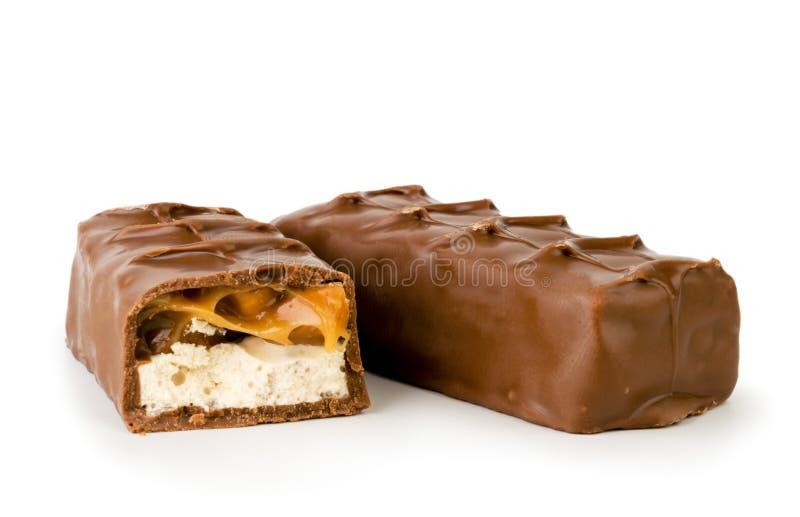 巧克力窃笑和半关闭-在白色 查出 库存图片
