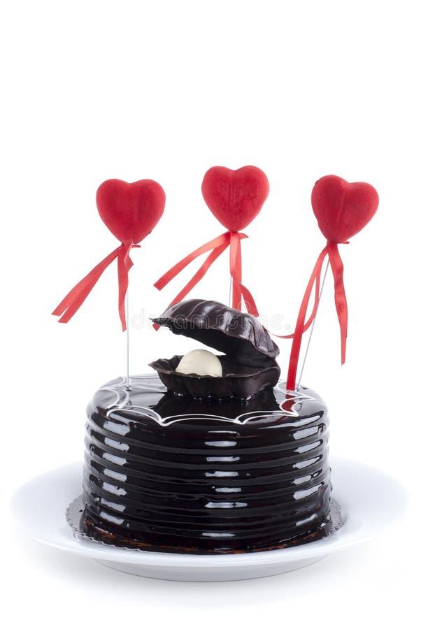 巧克力蛋糕和红色心脏 库存图片