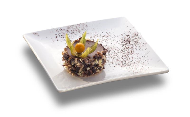 巧克力蛋糕圆用在上面的果子 免版税库存图片