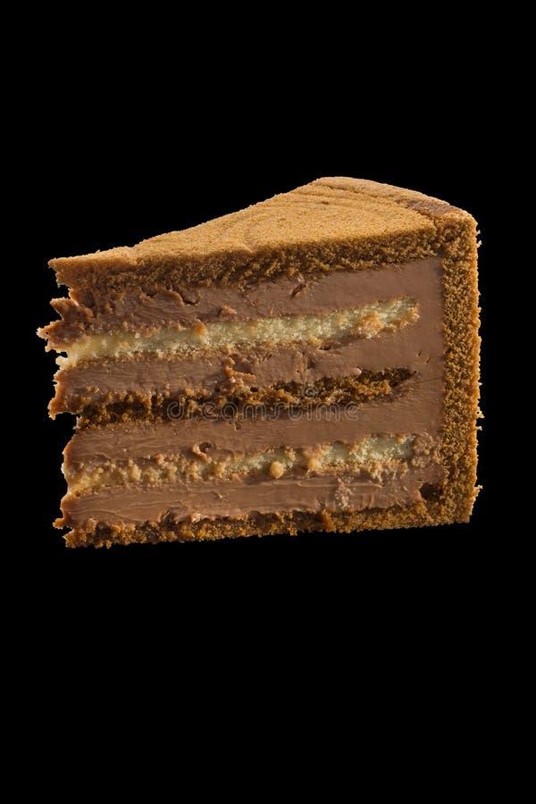 巧克力蛋糕片断与巧克力奶油的 被隔绝的ove 库存照片