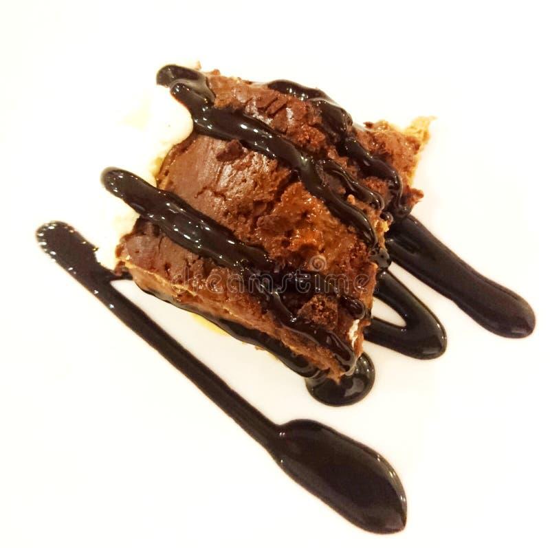 巧克力蛋糕用糖浆 免版税库存照片