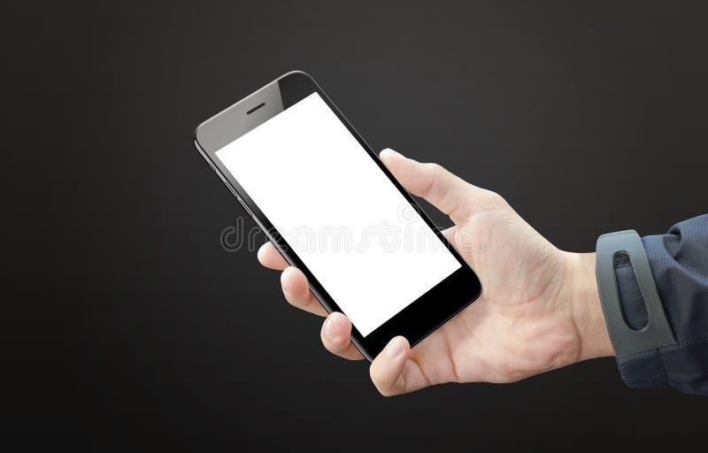 黑巧妙的电话在人手上 移动设备黑屏大模型的 图库摄影