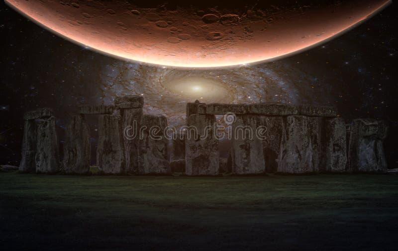 巨石阵与夜空和行星,威尔特郡,英国的一座古老史前石纪念碑 免版税图库摄影