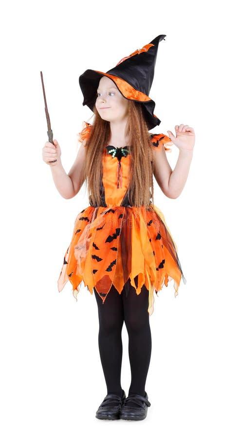 巫婆橙色服装的小女孩为万圣夜 库存照片