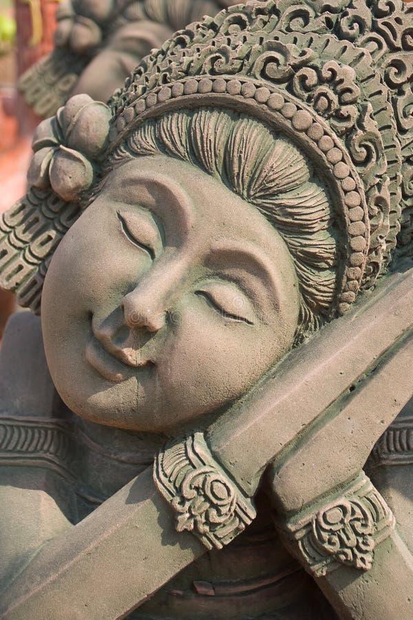 巴厘岛雕塑微笑 免版税库存图片