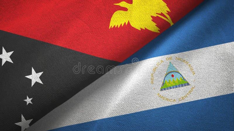 巴布亚新几内亚和尼加拉瓜两旗子纺织品布料,织品纹理 皇族释放例证