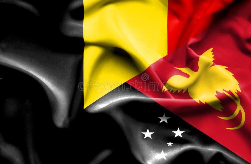 巴布亚新几内亚和比利时的挥动的旗子 皇族释放例证